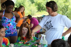 Volunteer helping 4-H'ers with outdoor education class