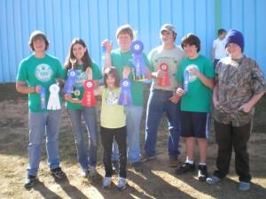 Leon County 4-H youth displaying ribbons at North Florida Fair