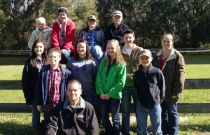 Brad and Stacey with members of their livestock judging team in 2015.