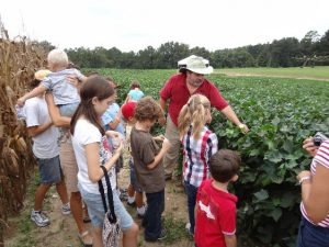 Ag Agent Jed Dillard teaching youth about cotton. Do you know how many pairs of jeans you can make out of a bale of cotton?