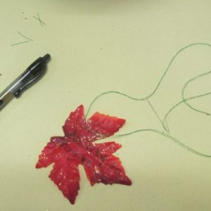Use a gel pen to write what you are thankful for on each leaf