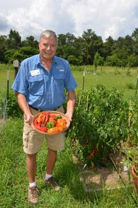 Wakulla Master Gardener Bill Osborne shows off some of the peppers he grew.