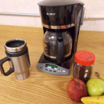 coffee maker with mug and fruit