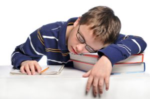 Sleeping_boy_at_desk_with_books[1]