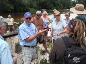 Rick O'Connor shows non-venomous snake to kayakers on recent field trip.