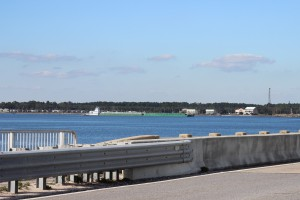A barge travels beneath the Navarre Beach Bridge as it heads east along the ICW.