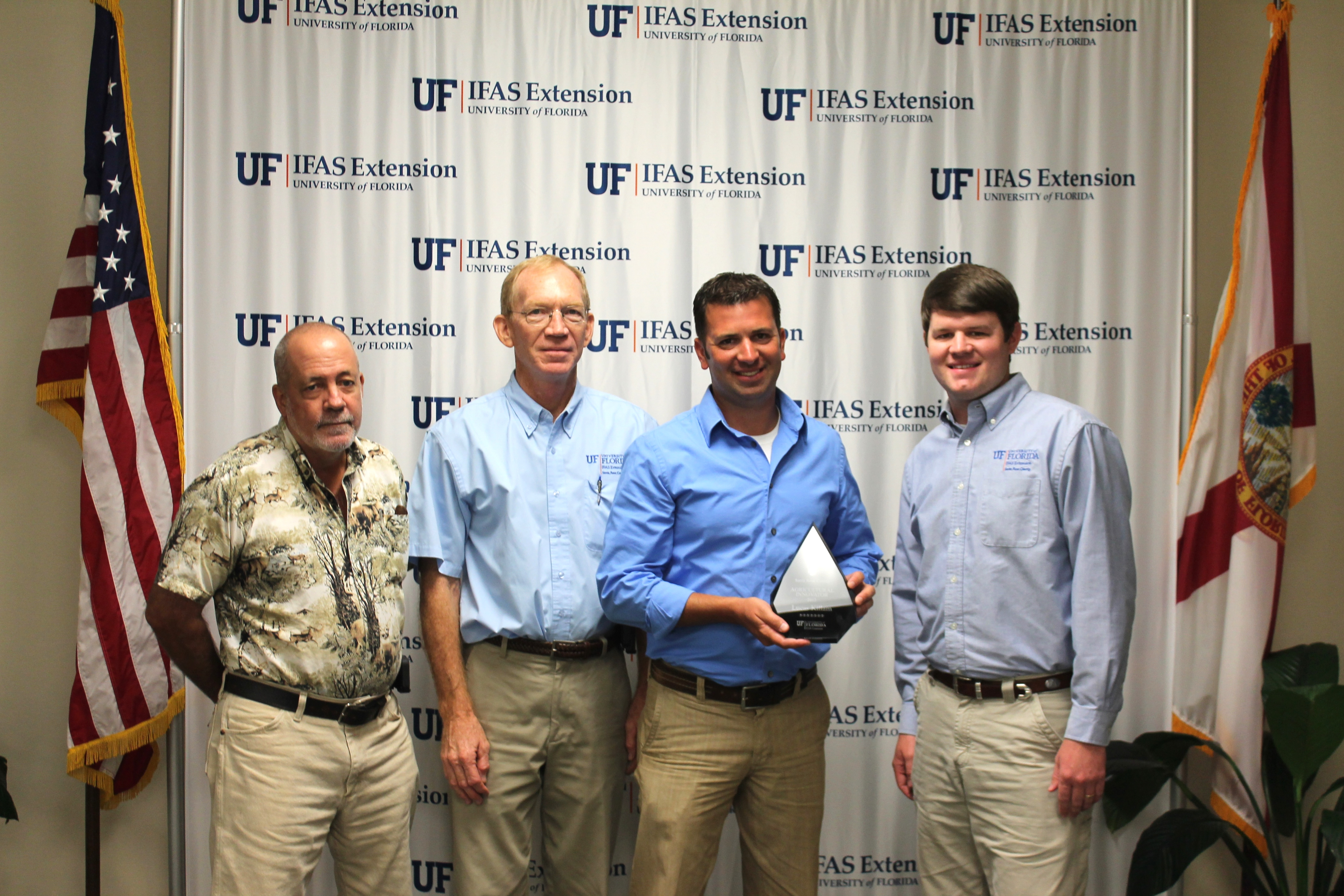 (Left to Right) John Atkins and Mike Donahoe of Santa Rosa County Extension, Lucas Killam, and Blake Thaxton of Santa Rosa County Extension