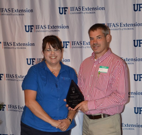 Libbie Johnson, Escambia County Extension presented the Ag innovator Award to Brent Yoder.