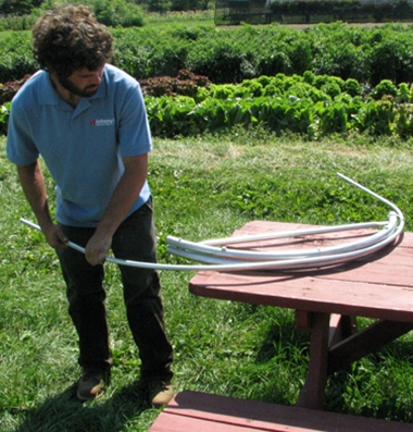 A hoop bender being used to fashion a hoop from a length of electrical conduit. Photo credit – Johnny's Seeds