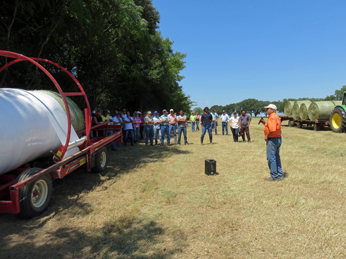 Bill Conrad, who operates a custom harvesting service talked with the group about making baleage. Photo Credit: Doug Mayo